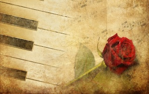 sheet music with red rose sepia