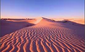 red dunes behine 80 mile